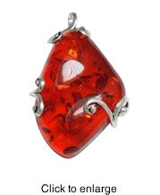 """Siluxe silver tone simulated cherry Amber pendant. Designed with a 42x70 mm simulated cherry colored Amber stone. Pendant is 1 7/8"""" wide by 2 3/4"""" long. This item is fine silver plated.  Suggested Retail Price: $19.50  Blow Out Wholesale Price: $6.50"""
