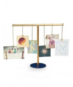 Secure up to six photos on the hanging hoops to create an eye-catching collection of favorite moments. Then easily refresh the display by swapping in new images, postcards, or even inspirational message cards for ultimate personalization. Put it on your desk at work or on a table in the foyer.