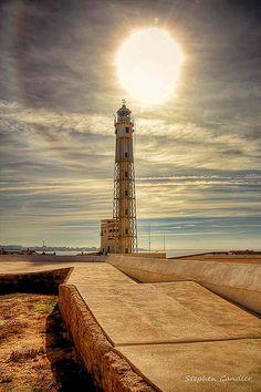 Sun halo behind the #lighthouse at Castillo de San Sebastian, Cadiz #Spain