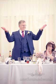 Father of the bride encourages guests Holme for Gardens Dorset wedding. Photography by one thousand words wedding photographers