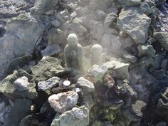 Jizo at Mt Osore, symbolically guiding the souls of the dead across the Sai no Kawara (dry river bed) that separates this world from the next