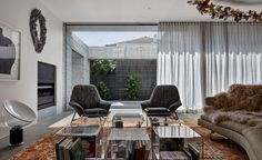 Among rows of impeccably restored Victorian and Federation-style mansions in Melbourne's leafy Armadale, BE Architecture's house stands firmly. Comprising a hefty granite façade – some 260 tonnes to be precise – one would assume its presence was imposi...