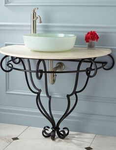 Set on a wrought iron frame with flowing lines that gather at the base, this sink stand creates a pretty display for any vessel sink. Dress up a powder room or master bathroom with this lovely piece.