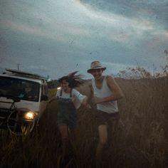 Cute Couple running through a field