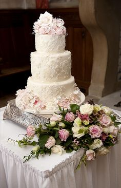 Three tier ivory and pink lace cake : Ivory and pink lace wedding cake.