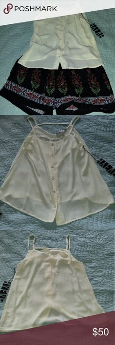 """****OUTFIT BUNDLE****   Ivory tank/Floral shorts Beautiful brand new outfit.  Super bummed that it's a little small on me.  Both are mediums. Waist on the shorts are stretchy and measure 14"""" across and stretch to 19"""" across. 3.5"""" inseam ****BOTH ITEMS CAN BE SOLD SEPARATELY**** Infinity Raine Shorts"""