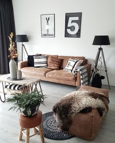 Brown leather distressed sofas with black and cream accessories