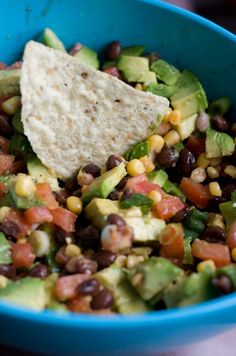 Black beans, tomato, avocado, onion, cilantro and corn.