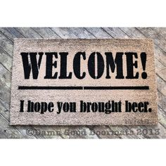 For a man cave. Beer lovers Welcome I Hope You Brought Beer by DamnGoodDoormats, $45.00