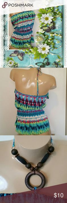 "Sassy Strapless- Backless Wooden Tie Top Super adorable, a size small, 100% polyester, does not have hardly any stretch, will fit a bust size of 30-34"", elastic waist 24 - 32 inches, 16 and a half inches long from underarm to hem line, cute wooden neck strap,  from a smoke-free and pet-free home, in great condition Mustard Seed Tops"