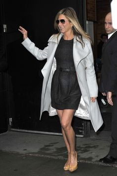 Jennifer Aniston in long, silver peacoat