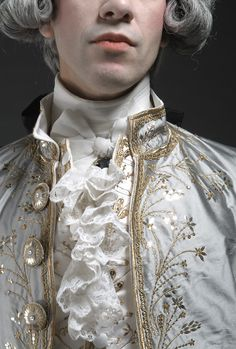 """Les amants jaloux."" Close-up of a recreation of the costume of an 18th-century French gentleman. Posted on chenillesetpapillons.com."