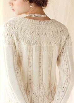 Hitomi Shida  http://www.ravelry.com/patterns/library/5-round-yoke-lace-cardigan