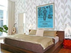 """""""I find that sometimes my clients like the idea of wallpaper but are nervous to commit to a whole room. By putting it on just one accent wall, say behind the bed in a bedroom or to create a focal point behind a sofa in a living room, you can get the upside without overdoing it,"""" says Gulley. Design by Michael Moeller."""
