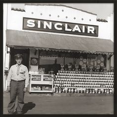 My grandad at his Sinclair gas station, 1940's. The sign is hanging in my office.