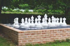 Wedding games. Maybe have these oversized chess pieces on a big wooden platform/table instead?