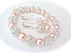 Pearl bracelet and earring set ~ Chunky ~ Swarovski pearls and crystals ~ Sterling silver ear wires ~ Bridal jewelry ~ Bridesmaids ~ SHARP Bisuteria Fina Information on our Site Pearl Jewelry, Wire Jewelry, Jewelry Sets, Jewelry Crafts, Pearl Bracelet, Wedding Jewelry, Beaded Jewelry, Jewelry Bracelets, Jewelery