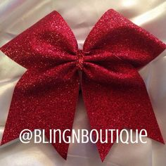 "Sparkle with this all red glitter bow with a red glitter center. BlingNBoutique bows are handmade to order. Unless otherwise stated in the individual description, they are made from 3"" grosgrain ribbo"
