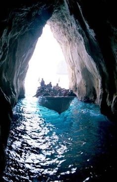 Blue Grotto, Capri Italy. When you go in it there's this part where you have to lay down in the tug-boat.....not fun. But otherwise very cool and fun. My sister said it was scary cause they were singing and it sounded like we were getting kidnapped by pirates!