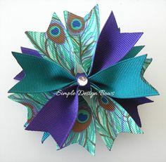 Peacock Hair Bow - Medium Spike Bow - Purple and Teal via Etsy....very pretty