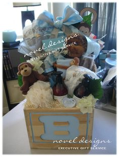 Custom Monkey Mommy & Me Celebration Gift Basket Including Champagne. Created by Novel Designs Executive Gift Service of Las Vegas. Baby Boy Gift Baskets, Baby Shower Baskets, Diy Gift Baskets, Baby Boy Gifts, Gifts For Boys, Baby Boys, Custom Baby Gifts, Customized Gifts, Creative Gifts