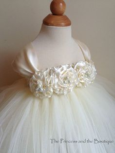 Items similar to Ivory flower girl dress with ivory hand rolled flowers. Tutu dress on Etsy Princess Tutu Dresses, Baby Tutu Dresses, Ivory Flower Girl Dresses, Flower Girl Tutu, Little Girl Dresses, Tulle Dress, Girls Dresses, Pagent Dresses, Dresses Dresses
