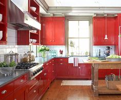Bold, red cabinets with white backsplash