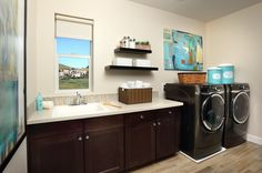Dirty laundry doesn't stand a chance in this gorgeous space! | Colina Plan 3 Laundry Room | by SheaHomesNoCal