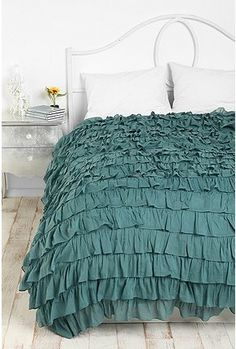 I think these ruffle bedspreads are starting to grow on me...but Ethan would NEVER go for it!