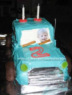 Homemade Pick Up Truck Cake Design: First, let me say that I am NOT a cake maker, but after my son requested an Aqua Pick-up Truck Cake for his 2nd birthday, I was inspired by the cakes on