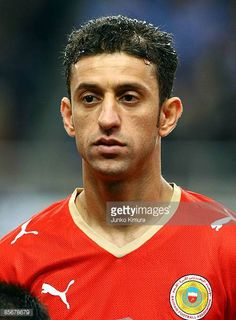Mohamed Hubail of Bahrain lines up for national anthems during the 2010 FIFA World Cup Asian qualifier match between Japan and Bahrain at Saitama...