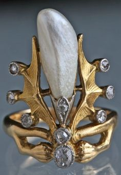 A superb Symbolist ring attributed to FRANK WALTER LAWRENCE, circa 1900. Gold, baroque pearl and diamonds. #FrankWalterLawrence #Symbolist #ring