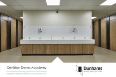 An excellent example of an open plan washroom design using Dunhams' Altitude toilet cubicle system.