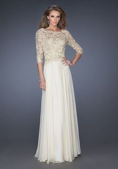 Sophisticated high scoop neckline gown with a chiffon skirt. The sleeves and bodice feature gorgeous lace, with a small keyhole opening in the back. Back zipper closure. Evening Collection Size Chart A.