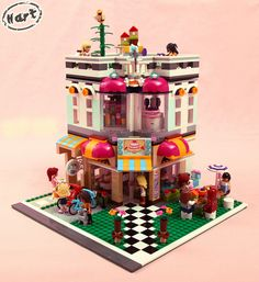 What happens when you combine the Lego Friends Downtown Bakery with the famous Lego Cafe Corner You get a Lego Friends Corner. Lego Friends, Lego Village, School Murals, Lego For Kids, Lego Modular, Cool Lego Creations, Lego Storage, Lego Worlds, Lego House