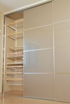 Wardrobe Sliding 4 Panel Doors. Panels are Stylite Champagne. elfa decor shelving compliments this beautiful Wardrobe