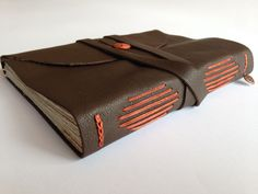 Love the burnt orange and brown leather combination. Made with Love, of course, in the USA!