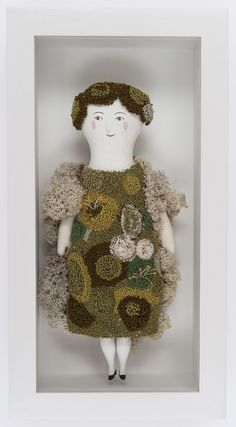 I wonder how the artist did the moss? Embroidery? French Knots? Punch Needle? More of her dolls are in my Dolls board.