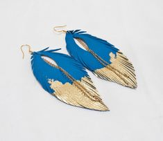 Hey, I found this really awesome Etsy listing at http://www.etsy.com/listing/103592780/leather-feather-earrings-blue-with-gold
