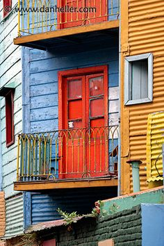 Red balcony door, Buenos Aires, La Boca, Argentina.  Photo By Dan Heller.