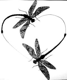 dragonfly heart tattoo design with the word 'mom'  in the middle