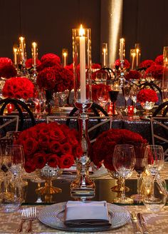 Dozens of different types of roses covered the tables from fire and ice to black magic. #WeddingCenterpieces