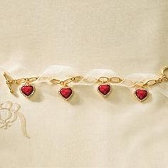 Red Heart Charm Bracelet in Winter 2013 from Uno Alla Volta on shop.CatalogSpree.com, my personal digital mall.