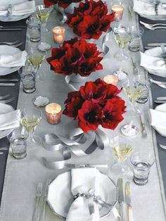 Red Amaryllis Bouquets Bouquets of bold-red amaryllis tied with stiff silver ribbon and displayed down the center of a table look stunning against the hushed gray, white, and silver setting. (I would replace the silver with black) *Mandi Christmas Table Settings, Christmas Tablescapes, Christmas Centerpieces, Christmas Decorations, Holiday Decor, Red Centerpieces, Holiday Tablescape, Centerpiece Flowers, Centerpiece Ideas