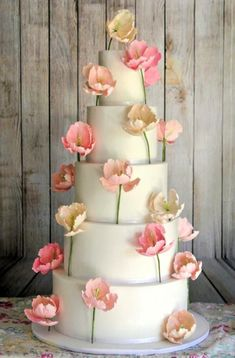 The Modern Bride She is free spirited and filled with a zest for life. Caring and compassionate… just as the symbolic nature of the pink tulip Classy and graceful, yet whimsy and down to earth A 5 tier display: 24 tulips. Beautiful Wedding Cakes, Gorgeous Cakes, Pretty Cakes, Amazing Cakes, Tulip Cake, Floral Cake, Cupcakes, Cupcake Cakes, Foto Pastel