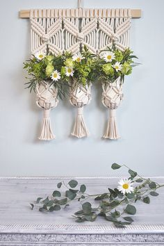 Macrame plant hanger decor idea by Amy Zwikel Studio. Perfect unique macrame piece for plants, candles or flowers.