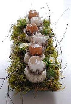 Wunderschöne Frühlingsdeko mit leeren Eiern als Kerzen. Natur Materialien bleiben einfach die schönsten