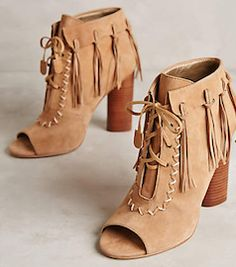 Stylish light brown suede boots