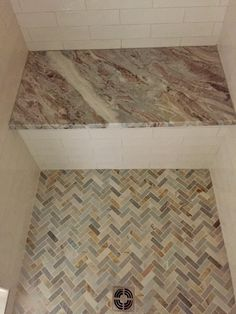 Carrara Marble With Metal Tile Accent On Walls And