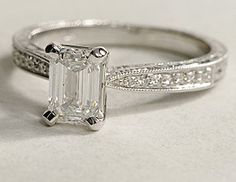 I LOVE THIS RING!!!!   Resembles the one I received for Christmas a few years ago except mine is a princess and not emerald.   Engraved micropave 1.01 ct. emerald cut diamond ring in 18k white gold. $4729. From Blue Nile.